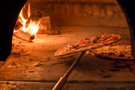 pizza: Brick oven with flames and ember ready to cook a delicious pizza