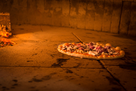 Brick oven with flames and ember ready to cook a delicious pizza