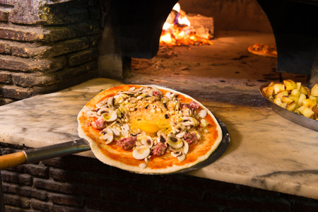 Brick oven with flames and ember ready to cook a delicious pizza photo