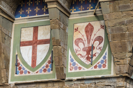 Detail of two emblems of the Florentine Republic on the facade of the Palazzo Vecchio in Florence