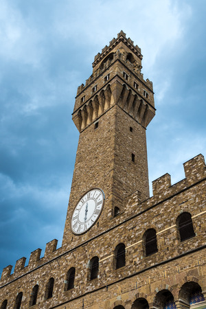 Arnolfo tower, clock with only one hand, bottom perspective view of the Palazzo della Signoria or Palazzo Vecchio, Piazza della Signoria in Florence