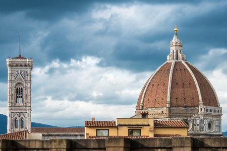 Giottos Bell Tower and Brunelleschis Dome of the Basilica Santa Maria del Fiore in Piazza del Duomo in Florence, high view from among the roofs of the city