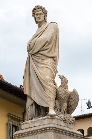 Marble statue of Dante Alighieri with eagle shot from below in Piazza Santa Croce in Florence