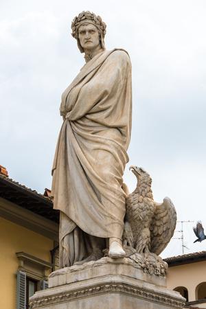 dante alighieri: Marble statue of Dante Alighieri with eagle shot from below in Piazza Santa Croce in Florence