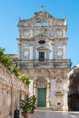 Church of Saint Lucia in Badia, Piazza Duomo, Ortigia, Siracusa, Sicily, Italy against the blue sky in the raking light of the morning