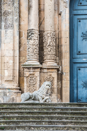 Detail of the facade of the church of San Sebastiano with columns and a marble lion in Palazzolo Acreide Siracusa Sicily Italy
