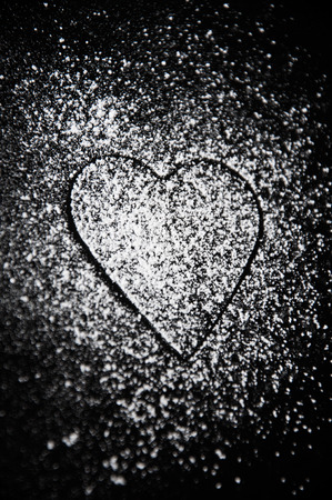 Thin lined form of heart in a sugar powder