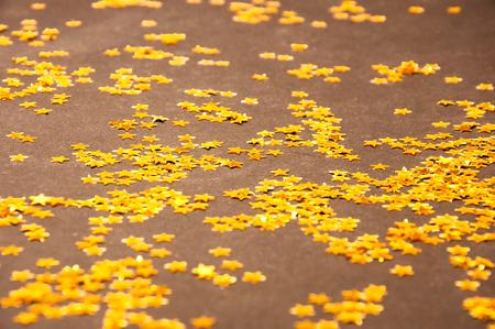 Golden small Stars on a dark background