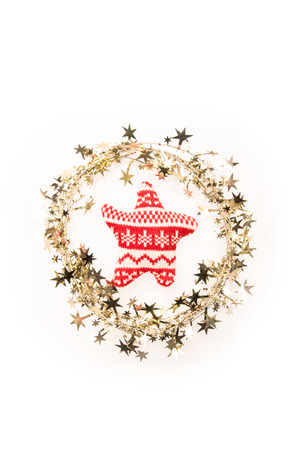 Christmas garland with golden stars and a toy-star inside on a white background