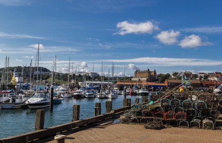Fishing boats and lobster pots at Scarborough harbour Editorial