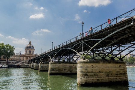 View of pedestrian crossing Seine river on Pont des Arts bridge in Paris 写真素材