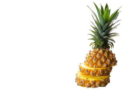 Isolated stack of sliced pineapple on white background, tropical fruit, summer concept, copy space