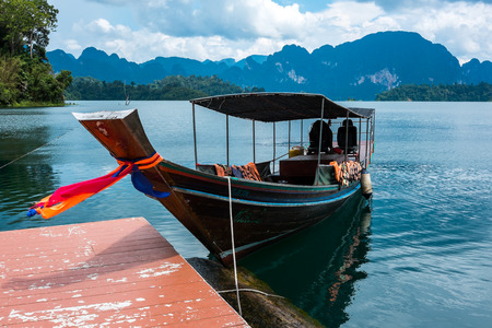 long tailed boat: Wooden long tailed boat