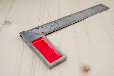 millimetre: Metal angle ruler on wood background