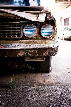 rusty car: Old rusty car headlight