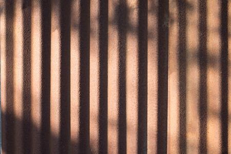 tree shadow: Old rusty galvanized with tree shadow.