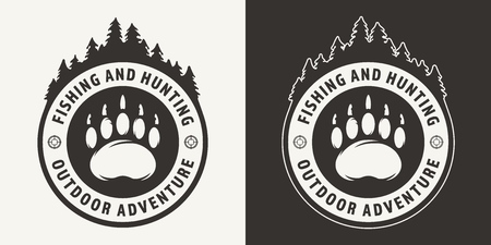 Vintage monochrome hunting round emblem with bear footprint and forest silhouette isolated vector illustration