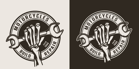 Vintage motorcycle repair service round emblems with skeleton hand holding wrench isolated vector illustration