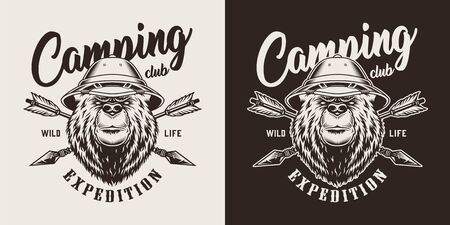 Vintage monochrome camping label with serious bear head in safari hat and crossed arrows isolated vector illustration 向量圖像