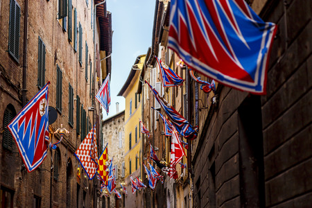 Banners of the contrads in Siena. Feast Palio. Region of Tuscany, Italy, europe Stok Fotoğraf - 98006194