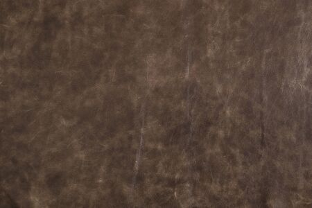Natural brown leather for leather crafting, leather worker, fashion design and interior design. Фото со стока
