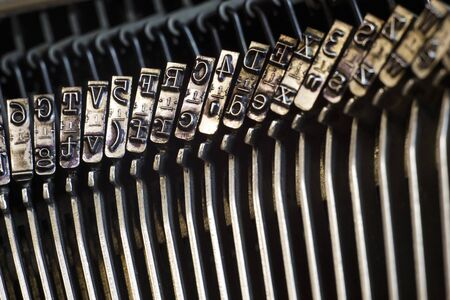 Close-up letters of retro typewriter machine.