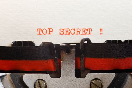 Top secret. The text is typed on a vintage typewriter, close up.