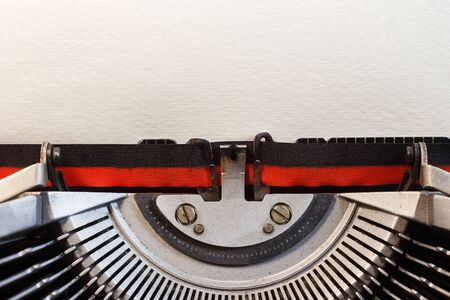 Vintage typewriter with blank paper. Space for text. The concept on literature, historical, education.
