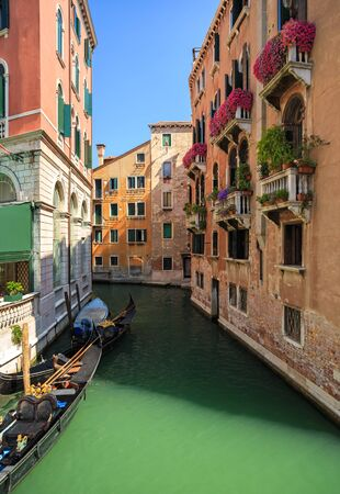 Picturesque Venice Canal with gondolas. Veneto, Italy. Standard-Bild