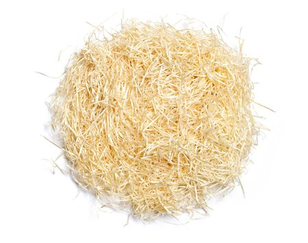 Shredded wood shavings for gifting, shipping and stuffing on white background. Natural wooden Top view.
