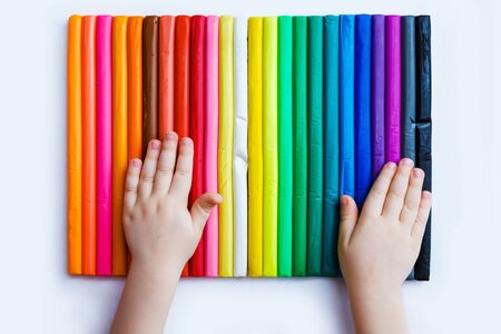 Child play with colorful plasticine. Set of plasticine palettes, rainbow colors