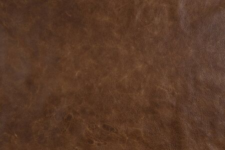 Natural luxury brown leather texture background. closeup