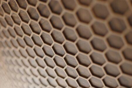 Wooden hexagonal, abstract macro texture for background Standard-Bild