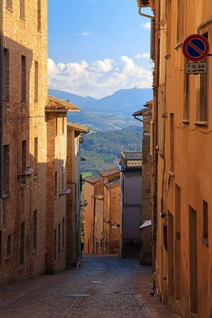 Narrow alley in the medieval town Urbino, Marche, Italy.
