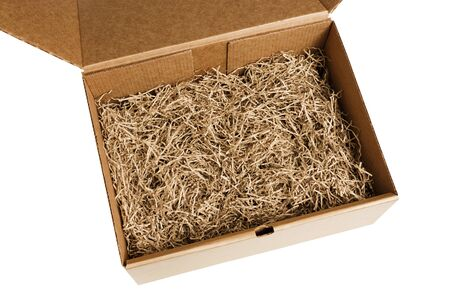 Opened gift box with decorative shredded paper for gifting and stuffing.