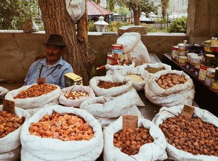 A man sold dried fruits at main bazaar in Leh City, India