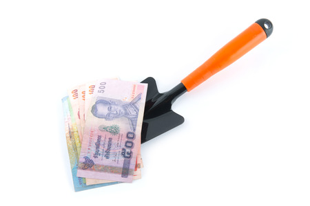 baht: Scoops and money. On a white background