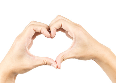 male hands in the form of heart isolated on white background photo
