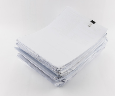 chaos order: piled up office work papers