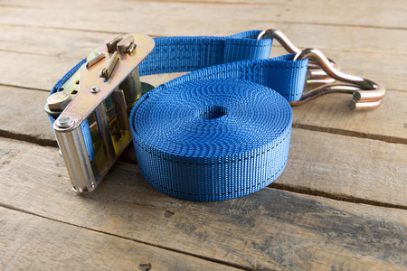 ratchet: tie down strap ratchet on wood