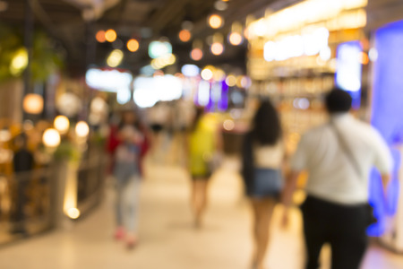 blurred image of shopping mall and people 写真素材