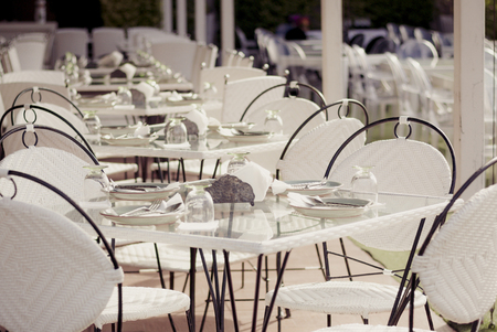 restaurant tables: Empty tables at an outdoor restaurant