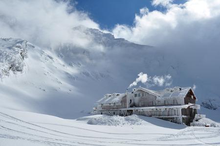 Cabin in winter, Balea Lake, Romania, Fagaras mountain  Editorial