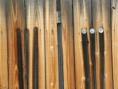 wood fence with washers photo
