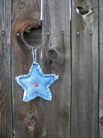 Denim star on fence photo