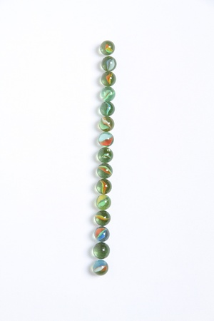 Line of colored marbles photo