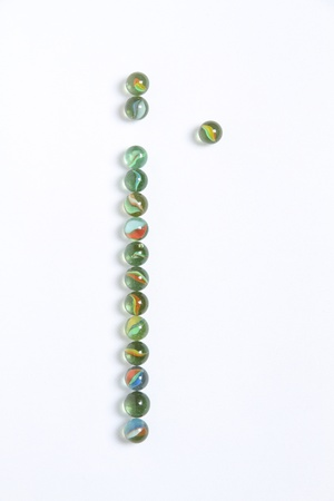 Line of colored marbles with one stands out photo