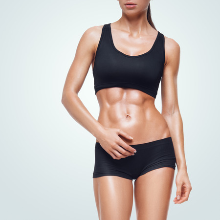 Fitness sporty woman walking. Strong abs showing.