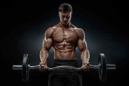 gym: Closeup portrait of a muscular man workout with barbell at gym. Brutal bodybuilder athletic man with six pack perfect abs shoulders biceps triceps and chest. Deadlift barbells workout.