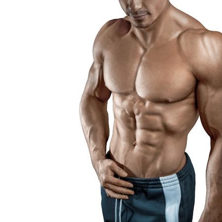 sin camisa: Modelo masculino muscular joven y en forma física culturista aislado en fondo blanco